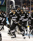 Tom Parisi (PC - 6), Kyle McKenzie (PC - 5) - The Providence College Friars defeated the Boston University Terriers 4-3 to win the national championship in the Frozen Four final at TD Garden on Saturday, April 11, 2015, in Boston, Massachusetts.