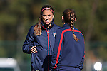 14 October 2014: Alex Morgan (left) talks with Christie Rampone (right). The United States Women's National Team held a training session on the stadium field at Swope Park Soccer Village in Kansas City, Missouri in preparation for the CONCACAF Women's World Cup Qualifying Tournament for the 2015 Women's World Cup in Canada.