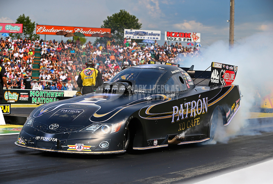 Aug. 2, 2014; Kent, WA, USA; NHRA funny car driver Alexis DeJoria during qualifying for the Northwest Nationals at Pacific Raceways. Mandatory Credit: Mark J. Rebilas-USA TODAY Sports