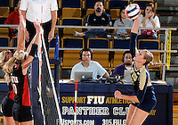 Florida International University women's volleyball player Una Trkulja (7) plays against Western Kentucky University.  Western Kentucky won the match 3-0 on September 30, 2011 at Miami, Florida. .