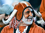 A Texas Longhorn fan wears his autographed longhorn hat before the game between the Oklahoma State Cowboys and the University of Texas in Austin Texas Longhorns at the Daryl K. Royal- Texas Memorial Stadium in Austin, Texas. The Oklahoma State Cowboys defeated the Texas Longhorns 33 to 16.