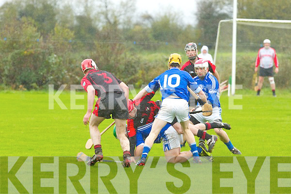 AIB Munster Club Junior Hurling Championship Quarter Final which took place on Sunday at 2pm in Kevin Long Park, Feenagh.  Referee Paul Foley of Waterford.  Feenagh-Kilmeedy VS Kenmare Shamrocks.  <br /> <br /> Jimmy O'Sullivan (14) of Feenagh/Kilmeedy (on ground), Micheal O'Sullivan (7) of Kenmare Shamrocks (on top of him) surrounded by Feenagh/Kilmeedy players Diarmuid Coleman (10) and Liam Murphy (3) and Kenmare Shamrocks players Maurice Fitzgearld (3) and Tommy O'Sullivan (2) captain.