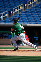 Daytona Tortugas first baseman James Vasquez (15) follows through on a swing during the first game of a doubleheader against the Clearwater Threshers on July 25, 2017 at Spectrum Field in Clearwater, Florida.  Daytona defeated Clearwater 4-1.  (Mike Janes/Four Seam Images)