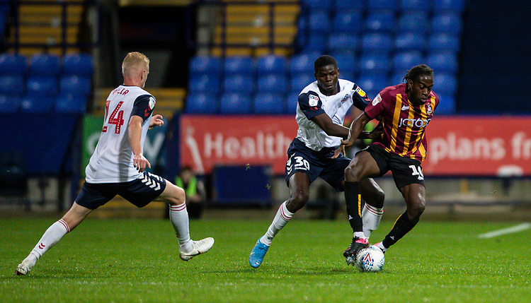 Bolton Wanderers' Yoan Zouma (centre) competing with Bradford City's Clayton Donaldson <br /> <br /> Photographer Andrew Kearns/CameraSport<br /> <br /> EFL Leasing.com Trophy - Northern Section - Group F - Bolton Wanderers v Bradford City -  Tuesday 3rd September 2019 - University of Bolton Stadium - Bolton<br />  <br /> World Copyright © 2018 CameraSport. All rights reserved. 43 Linden Ave. Countesthorpe. Leicester. England. LE8 5PG - Tel: +44 (0) 116 277 4147 - admin@camerasport.com - www.camerasport.com