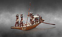 Ancient Egyptian wooden model boat from tomb of Shemes,  Middle Kingdom (1980-1700 BC), Asyut. Egyptian Museum, Turin.  Grey background.<br /> <br /> In 1908 in Asyut, Egypt an intact tomb was discovered of an official named Shemes, it contained many rich grave goods. Two rectangular Coffins, one for Shemes and the other for a woman called Rehuerausen, possibly his wife. They carry typical Middle Kingdom decorations,
