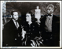 BNPS.co.uk (01202 558833)<br /> Pic:  Juliens/BNPS<br /> <br /> Victor Jory, Barbara O'Neil and Oscar Polk on set.<br /> <br /> Amazing behind the scenes photos of the classic film Gone With The Wind have come to light 80 years later.<br /> <br /> The comprehensive archive of over 800 images includes candid snaps of the leads Clark Gable and Vivien Leigh unwinding between takes.<br /> <br /> One extraordinary photo shows the pair still in costume playing a board game, with another capturing the burning of Atlanta in the film.<br /> <br /> There is also a picture of the director Victor Fleming holding the novel 'Gone With The Wind' while in discussion with Leigh.