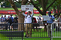 Washington, DC - August 12, 2018: A small group of people from 'Unite the Right' rally in Lafayette Park across from the White House August 12, 2018, as protesters on the other side of the park shout at them.  (Photo by Don Baxter/Media Images International)