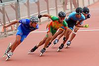 CALI - COLOMBIA - 02-08-2013: Prueba de los 1000 metros Mayores varones en patinaje de Velocidad en los IX Juegos Mundiales Cali, agosto 2 de 2013. (Foto: VizzorImage / Luis Ramirez / Staff). Competition of 1000 meters Senior Men In Speed Skating in the IX World Games Cali, August 2 2013. (Photo: VizzorImage / Luis Ramirez / Staff).