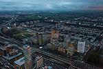 Nederland, Noord-Holland, Amsterdam, 16-01-2014; zicht op de Zuidas en de Ring A10 in de avondschemering en bij ondergaande zon. Omgeving Station Zuid-WTC, World Trade Centre (WTC) en hoofdkantoor ABN-AMRO.<br /> Verder in beeld , de woontorens Symphony 1 en 2 (onderdeel Gershwin), de Vinoly-toren en Ito-toren (onderdeel Mahler4), Atrium.<br /> Zuid-as, 'South axis', financial center in the South of Amsterdam, with o.a. headquarters of former ABN AMRO, World Trade Centre (WTC) en Ring Road A10. Amsterdam equivalent of 'the City', financial district. <br /> luchtfoto (toeslag op standaard tarieven);<br /> aerial photo (additional fee required);<br /> copyright foto/photo Siebe Swart.<br /> aerial photo (additional fee required);<br /> copyright foto/photo Siebe Swart.