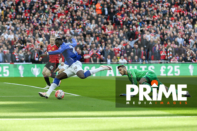 Romelu Lukaku of Everton (10) rounds David De Gea of Manchester United (right) only to see his shot headed away on the line by Wayne Rooney of Manchester United (left) during the FA Cup Semi-Final match between Everton and Manchester United at Wembley Stadium, London, England on 23 April 2016. Photo by David Horn / PRiME Media Images.