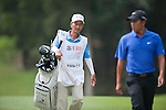 Cheng-tsung Pan of Taiwan and his caddie walk during Hong Kong Open golf tournament at the Fanling golf course on 25 October 2015 in Hong Kong, China. Photo by Xaume Olleros / Power Sport Images