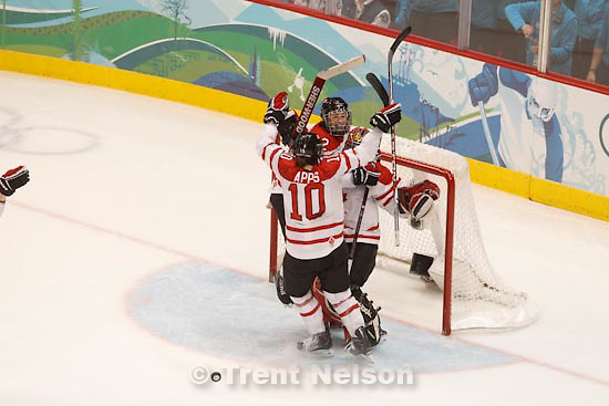Trent Nelson  |  The Salt Lake Tribune.Canada goalkeeper Shannon Szabados is swarmed by teammates Hayley Wickenheiser (22) and Gillian Apps. Canada defeats Team USA in the gold medal game, women's Ice Hockey at the Canada Hockey Place, Vancouver, XXI Olympic Winter Games, Thursday, February 25, 2010.