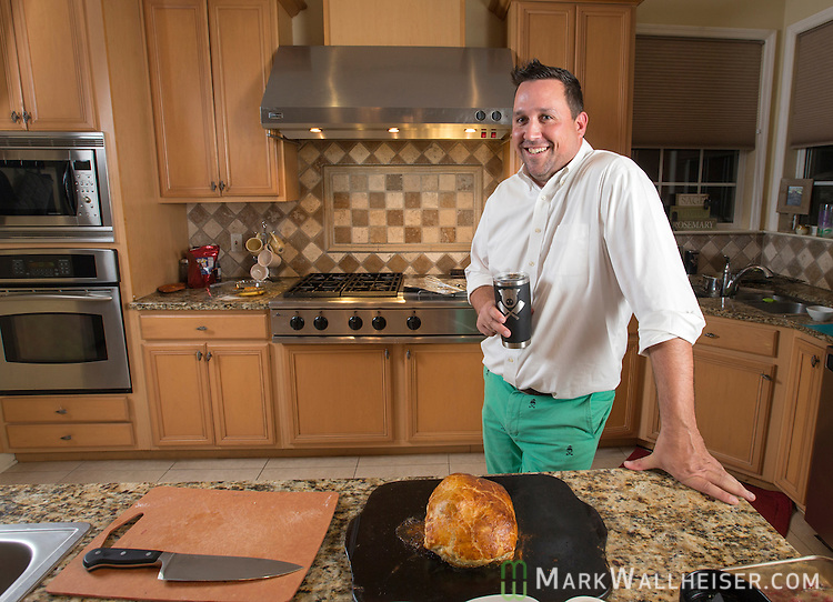 Josh Cooper prepares beef wellington at his home in Tallahassee, FL November 16, 2016.