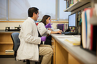 Dr. Dan Barouch (left) speaks with Kathryn Stephenson, MD and Instructor in Medicine, in the Barouch Lab at Beth Israel Deaconess Medical Center and Harvard Medical School in Boston, Massachusetts, USA. <br /> <br /> Dr. Dan Barouch is Professor of Medicine and physician at Beth Israel Deaconess Medical Center and Harvard Medical School in Boston, Massachusetts, USA. He is director of the Barouch Lab at the Center for Virology and Vaccine Research at Beth Israel Deaconess Medical Center and has recently published research on the evaluation of novel antibody therapy for HIV infection.<br /> <br /> CREDIT: M. Scott Brauer for the Wall Street Journal<br /> AIDS