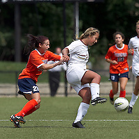 Boston College forward/midfielder Rachel Davitt (24) controls the ball as University of Virginia midfielder/forward Erica Hollenberg (23) pressures. Boston College defeated University of Virginia, 2-0, at the Newton Soccer Field, on September 18, 2011.