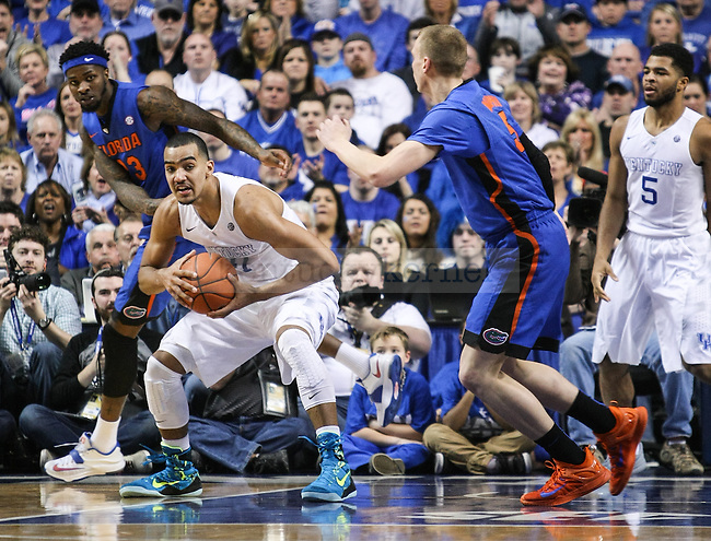Kentucky forward Trey Lyles guards the ball during the second half of the Kentucky vs. Florida game at Rupp Arena in Lexington, Ky.,on Saturday, March 7, 2015. UK defeated Florida 67-50, completing a perfect regular season. Photo by Adam Pennavaria | Staff
