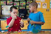 MR / Schenectady, NY. Zoller Elementary School (urban public school). Kindergarten classroom. Students pretend using play reptiles at free playtime. Left: boy, 5; Right: boy, 5, African American. MR: Gia3, Ste14. ID: AM-gKw. © Ellen B. Senisi.
