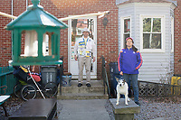 Carlos Arredondo, 57, (left) and his wife Melida Arredondo, 52, are seen in their front yard in Roslindale, Boston, Massachusetts, USA, on Sat., March 31, 2018. Arredondo is well known as the &quot;man in the cowboy hat&quot; who helped out in the aftermath of the Boston Marathon Bombing in 2013. Carlos is wearing a jacket that he has used to create a t-shirt design for when he runs the Boston Marathon later this year. Though he has run the race unofficially previously, this will be the first time he runs it &quot;legally,&quot; he says. <br /> <br /> Their dog, Buddy, age 18, can also be seen. Carlos says he often accidentally calls Buddy by his son's name, Brian. Brian Arredondo died by suicide in 2011 after a battle with depression following the 2004 death of Arrendondo's other son  Marine Lance Corporal Alexander Scott Arredondo, who was killed while serving in Iraq.