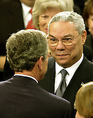 Washington, DC - January 28, 2003 -- United States President George W. Bush shares a thought with United States Secretary of State Colin Powell after he delivered his State of the Union Address to a Joint Session of the United States Congress.<br /> Credit: Ron Sachs / CNP