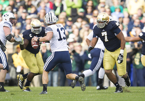 October 20, 2012:  Notre Dame defensive end Stephon Tuitt (7) pressures BYU quarterback Riley Nelson (13) during NCAA Football game action between the Notre Dame Fighting Irish and the BYU Cougars at Notre Dame Stadium in South Bend, Indiana.  Notre Dame defeated BYU 17-14.