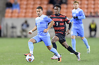 Houston, TX - Friday December 9, 2016: Nico Melo (31) of the North Carolina Tar Heels brings the ball up the field with Bryce Marion (7) of the Stanford Cardinal close behind at the NCAA Men's Soccer Semifinals at BBVA Compass Stadium in Houston Texas.