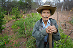 Pascual Antesano poses in his garden in the Guarani indigenous village of Choroquepiao, Bolivia. He and his neighbors started the gardens with assistance from Church World Service, supplementing their corn-based diet with nutritious vegetables and fruits.