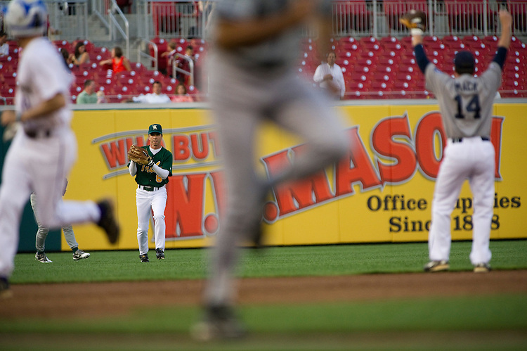 UNITED STATES - JULY 14: As Democrat runners advance (foreground), outfielder Rep. Rob Wittman, R-Va., prepares to throw to the infield during the 50th Annual Roll Call Congressional Baseball Game held at Nationals Stadium, July 14, 2011. Shortstop Rep. Connie Mack IV, R-Fla., is at right. (Photo By Scott J. Ferrell/Roll Call)