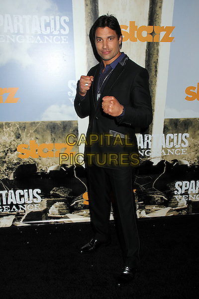 "Manu Bennett.""Spartacus: Vengeance"" Premiere Screening held at Arclight Cinemas, Hollywood, California, USA..January 18th, 2012.full length hands fists black suit.CAP/ADM/BP.©Byron Purvis/AdMedia/Capital Pictures."