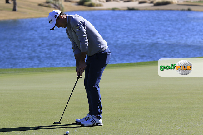 Nick Taylor (CAN) putts on the 18th green during Saturday's Round 3 of the 2017 CareerBuilder Challenge held at PGA West, La Quinta, Palm Springs, California, USA.<br /> 21st January 2017.<br /> Picture: Eoin Clarke | Golffile<br /> <br /> <br /> All photos usage must carry mandatory copyright credit (&copy; Golffile | Eoin Clarke)