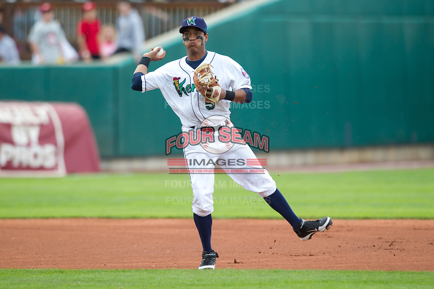 Cedar Rapids Kernels shortstop Jorge Polanco #5 throws during a game against the Kane County Cougars at Veterans Memorial Stadium on June 8, 2013 in Cedar Rapids, Iowa. (Brace Hemmelgarn/Four Seam Images)