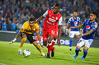 BOGOTA, COLOMBIA - MARCH 03: Jeisson Palacios of Santa Fe run for the ball against Cristian Arango of Millonarios during the match between Millonarios and Independiente Santa Fe as part of the Liga BetPlay at Estadio El Campin on March 3, 2020 in Bogota, Colombia. (Photo by John W. Vizcaino/VIEW press/Getty Images)