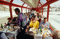 Passengers enjoy lunch at the panoramic car while the Glacier Express is crossing the Oberalppass.