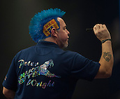 01.01.2014.  London, England.  William Hill PDC World Darts Championship.  Quarter Final Round.  Peter Wright (5) [SCO] in action during his game with Gary Anderson (4) [SCO]. Anderson won the match 5-1