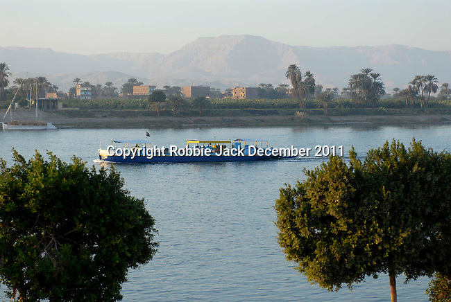 View from Luxor over the River Nile to the Theban Hills. The town of Luxor occupies the eastern part of a great city of antiquity which the ancient Egytians called Waset and the Greeks named Thebes.