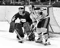 Seals Norm Ferguson and Vancouver Canucks goalie Dune Wilson...(1972 photo/Ron Riesterer)