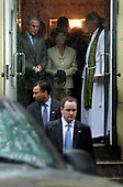 """United States President George W. Bush and first lady Laura Bush depart St. John's Church in Washington, D.C. on June 25, 2006 with umbrellas up in a downpour at 8:32AM following the service accompanied by the Reverend Dr. Louis Leon, rector of St. John's.  Reverend Leon presided and gave the sermon. The readings were from Job 38, Psalm 107, 2 Corinthians 5 and the Gospel was from Mark 4: 35-41.  In his sermon, Dr. Leon recalled his tearful departure from Cuba as an 11 year-old-boy on August 13, 1961, linking that to the Gospel of the day, which dealt with Jesus calming his disciples and the sea and the wind on a crossing of the Sea of Galilee. He said that Jesus was """"inviting us to go where we never thought we'd go,"""" adding that He offers us """"maximum support and minimum protection."""" Dr. Leon also made a passing reference to FDR's famous statement that we have nothing to fear but fear itself. <br /> Credit: Jay L. Clendenin - Pool via CNP"""