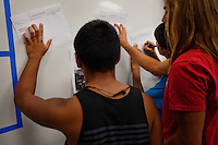 "Lindsay, California, September 5, 2012 - Students in Marisa Rodriguez's World History class break into groups to focus on the different stages of the French Revolution. Rodriguez says that the group participation engages the students more, forcing them to think more and dig deeper. Adding, ""It's important that they reach this on their own, in their own way. That is more meaningful to them.""..Lindsay High School began building a competency-based education model about 7 years ago, fully implementing it just over three years ago and is set to graduate its first class this school year. This model does away with traditional grading and pass/fail for grades. Instead students are expected to achieve proficiency in a range of areas in each class, where a 3 (equal to a traditional B) is passing; A 4 is considered intensive and usually denotes college bound. Says Principal Jaime Robles, ?This allows students to learn at there own pace. If a student is advanced, they can move ahead, and if a student is lagging, they get the support they need.? Part of this model allows for students who are more advanced dig deeper and push harder and truly move ahead of others. Because they are ahead, some spend the extra time learning more, others take concurrent classes at the nearby community college and some choose to graduate early to start their path. ?Each student has their own set of goals,? says English teacher Amalia Lopez, ?Whatever their goals are, we support them.?.Slug: DD_ CompetencyByline: Daryl Peveto / LUCEO for Education Week"