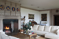 The great stone fireplace, with its display of coats of arms, is a prominent reminder of the importance of such architectural features centuries ago