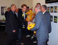 Prince Harry shakes hands with Hurricanes manager Tony Ward in the team changing rooms after the Super Rugby match between the Hurricanes and Sharks at Westpac Stadium, Wellington, New Zealand on Saturday, 9 May 2015. Photo: Dave Lintott / lintottphoto.co.nz