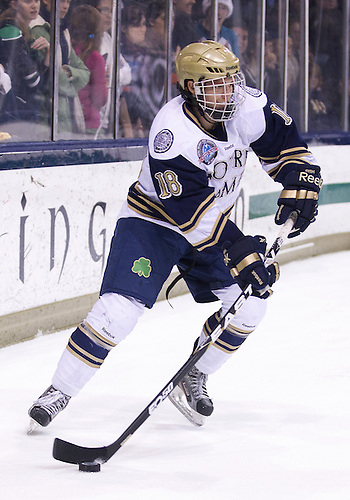 November 23, 2012:  Notre Dame center T.J. Tynan (#18) skates with the puck during NCAA Hockey game action between the Notre Dame Fighting Irish and the North Dakota Fighting Sioux at Compton Family Ice Arena in South Bend, Indiana.  North Dakota defeated Notre Dame 2-1.