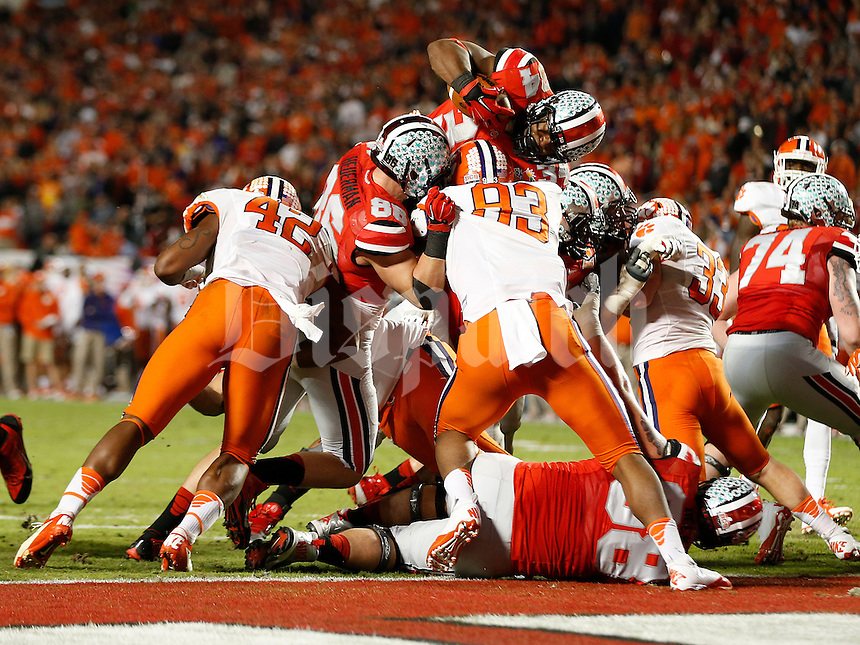 Ohio State Buckeyes running back Carlos Hyde (34) leaps for a touchdown in the third quarter of the Discover Orange Bowl between Ohio State and Clemson at Sun Life Stadium in Miami Gardens, Florida, Friday night, January 3, 2014. As of the fourth quarter the Ohio State Buckeyes led the Clemson Tigers 35 - 34.(The Columbus Dispatch / Eamon Queeney)