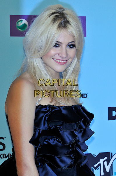 PIXIE LOTT .during the MTV Europe Music Awards 2009 at the O2 World Arena in Berlin, Germany, November 5th 2009..arrivals EMA EMAs half length strapless black smiling make-up braid twist in hair roots eyeliner dress ruffles ruffle .CAP/PL.©Phil Loftus/Capital Pictures