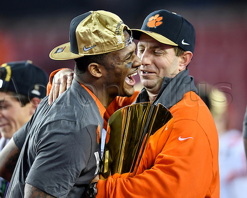 09.01.2017. Tampa, Florida, USA.  Clemson University head coach Dabo Swinney and Clemson University quarterback Deshaun Watson (4) have a laugh during the awards ceremony after the CFP National Championship game between the Alabama Crimson Tide and the Clemson Tigers on January 09, 2017, at Raymond James Stadium in Tampa, FL. Clemson defeated Alabama 35-31.