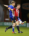 Connor Hall of Sheffield Utd tussles with Glen Loosens of Sheffield Wednesday during the U23 Professional Development League match at Bramall Lane Stadium, Sheffield. Picture date: September 6th, 2016. Pic Simon Bellis/Sportimage