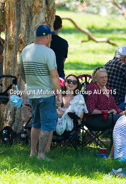 9 FEBRUARY 2015 SYDNEY AUSTRALIA<br /> <br /> EXCLUSIVE PICTURES<br /> <br /> Kate Ritchie pictured with her husband Stuart Webb and baby daughter Mae attending a family birthday in Centennial Park. Kate and Stuart were the picture of the perfect doting parents as they showed off Mae in a yellow dress to their friends and family before Kate put her on the breast for a feed. The is the first time the new parents have been snapped in public with Mae since her birth back in August 2014.