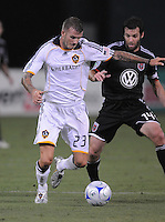 Los Angeles Galaxy midfielder David Beckham (23) shields the ball against DC United midfielder Ben Olsen (14) DC United tied with Los Angeles Galaxy 0-0 at RFK Stadium, Saturday August 22, 2009.