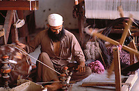 Pakistan Peshawar  1986.. Afghan works to the loom in Refugee Camp