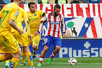 Atletico Madrid´s Turkish midfielder Arda Turan and Getafe´s Pedro Leon