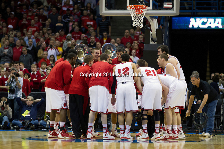 Wisconsin Badgers huddle prior to their third-round game in the NCAA college basketball tournament against the Oregon Ducks Saturday, April 22, 2014 in Milwaukee. The Badgers won 85-77. (Photo by David Stluka)