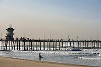 A Surfer Looking At The Waves Near The Huntington Beach Pier